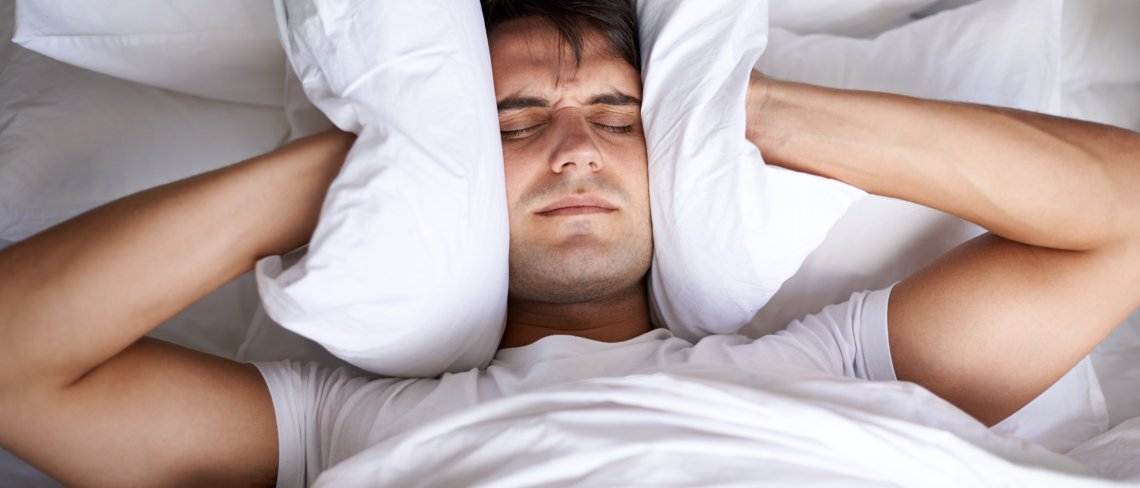 Person struggling to sleep
