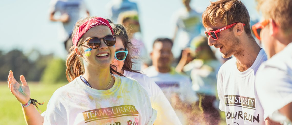 University of Surrey students on a colour run throwing paint powder