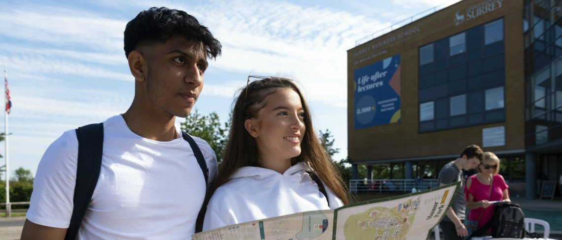 students holding a map at the University Open day