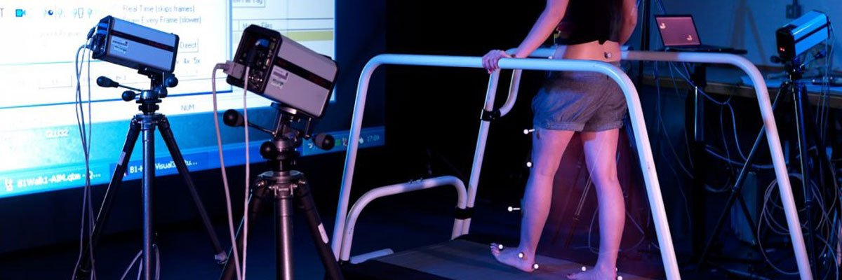 Student walking on treadmill in the Human Movement Laboratory