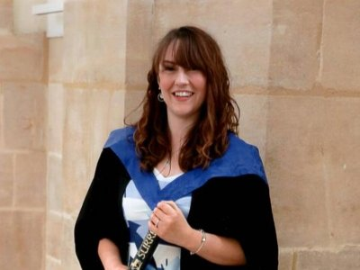 female midwifery student graduating