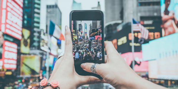 Person taking picture on their mobile phone in New York