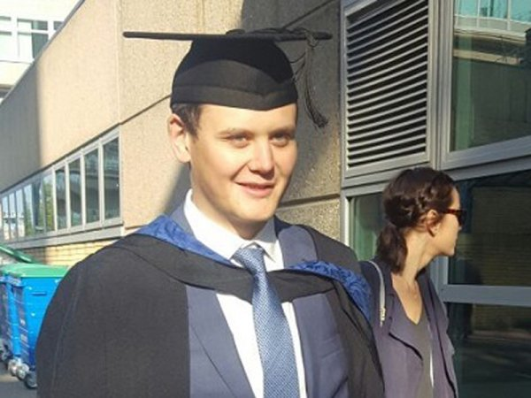 Kristian Fowler in his graduation gown