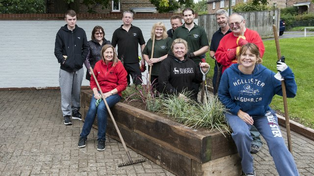 Estates team at a community garden