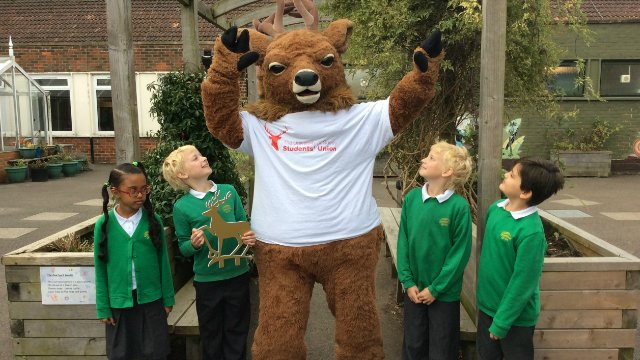 School pupils with the Surrey stag