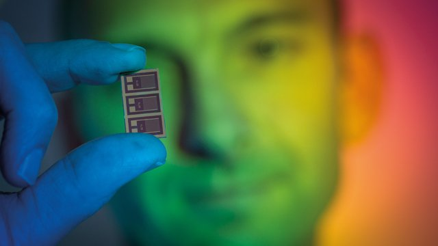 Man holding up multispectral' light sensor