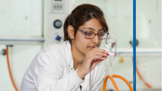 Female student in a chemistry lab