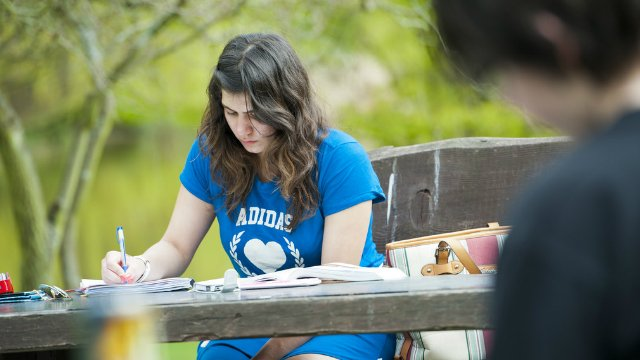 A female student writing outside