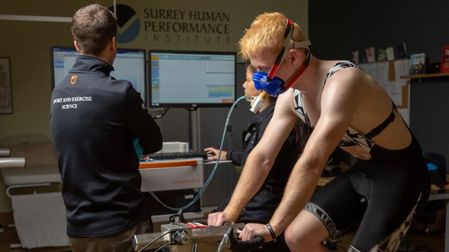 A man being tested on an exercise bike in the Surrey Human Performance Institute.
