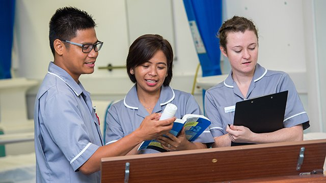 Three student nurses out in practice