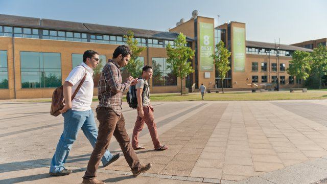 Prospective students walking across campus