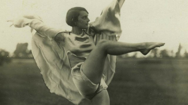 Old photo of woman dancing.