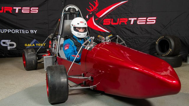 Student in a race car for team SURTES