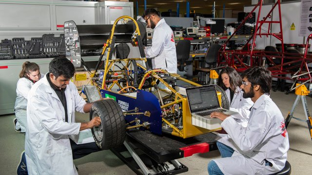 Students working on a race car