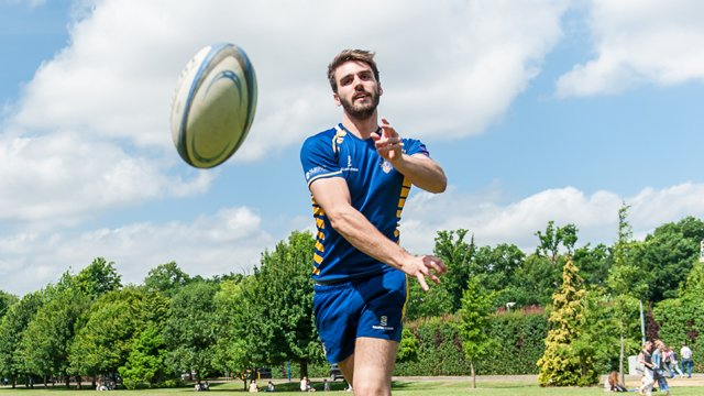 Male student throwing rugby ball
