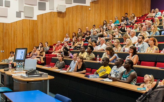 Speaker talking to audience in lecture theatre