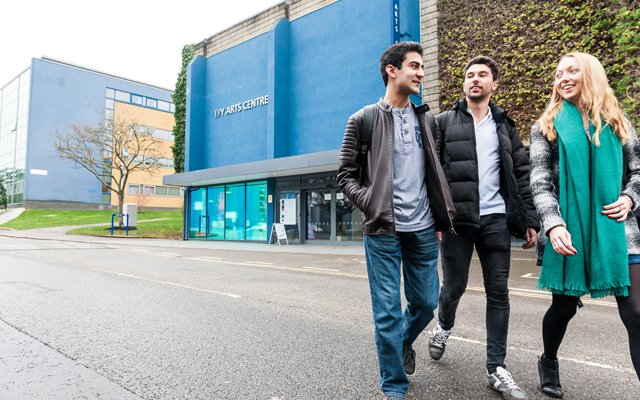 Students walking past the Ivy Arts Centre
