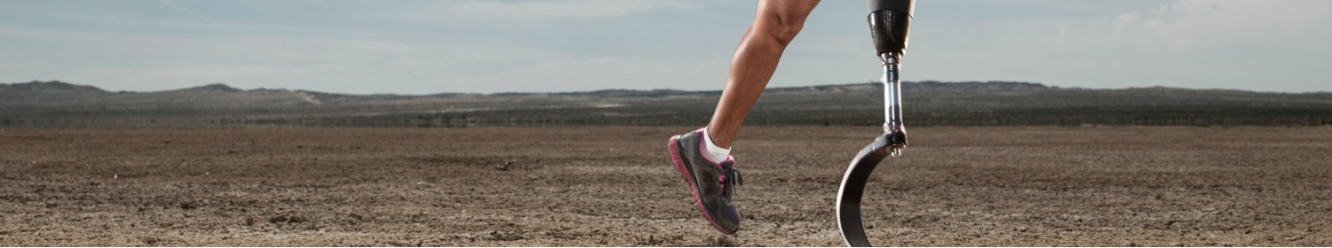Woman with prosthetic leg running