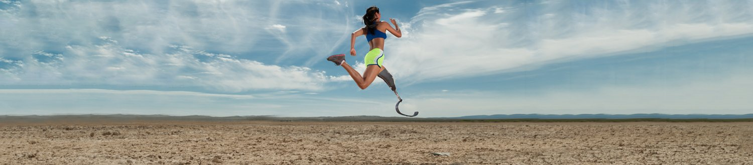 Woman running with biomechanical leg