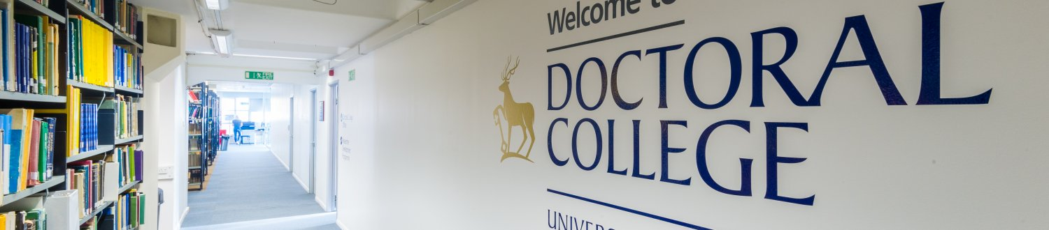 A wall in the Doctoral College at University of Surrey with the college name written on it