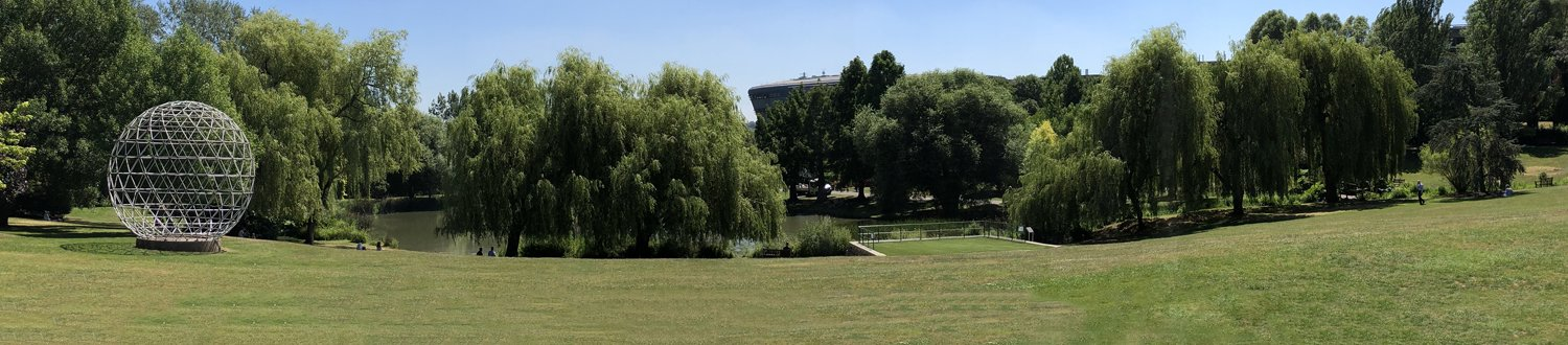 Panoramic photo of the campus by the lake with the globe