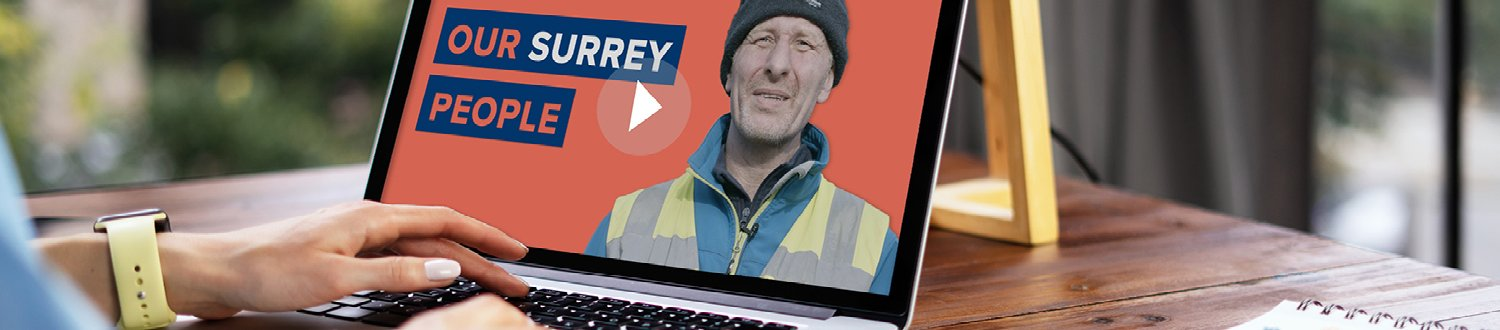 A person is looking an Our Surrey People campaign video on a laptop