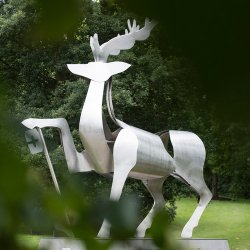 The university stag statue with leaves in the foreground