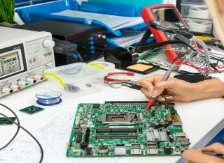Working on a circuit board with electronic components