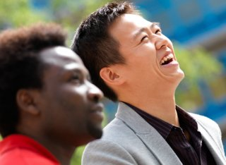 Two male students laughing