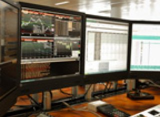 A computer operating three large screens