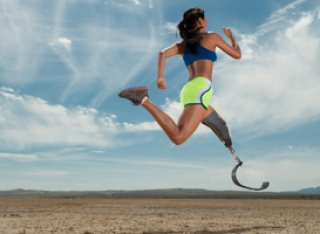 Woman running with bionic leg