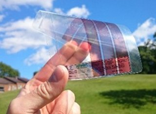 Hand holding up organic solar cells