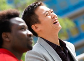 Two male student laughing