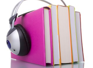 Books with headphones on top of them