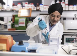 Hardev Pandha in the laboratory doing tests with tubes