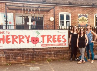University of Surrey staff stood outside Cherry Trees after volunteering in Guildford