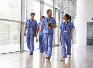 Group of doctors walking down the hallway of a hospital