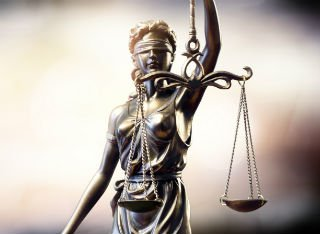 The scales of justice blindfolded