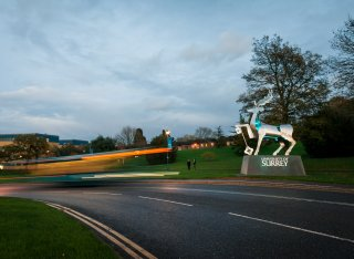 The University of Surrey entrance stag in the evening