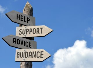 Sign post with the words help, support, advice and guidance listed