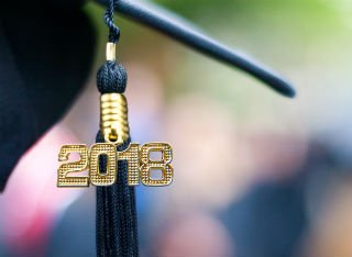 A mortar board with 2018 hanging from it