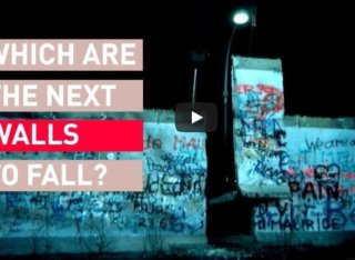 The Berlin Wall with 'Which are the next walls to fall?' written in text on top