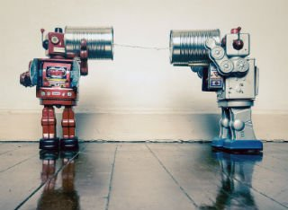 Two cute robots playing with a rope and cans to talk to each other