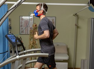 A man being tested on the treadmill in the Surrey Human Performance Institute.