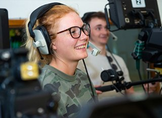 Film and video production students learning how to operate the broadcast studio for Surrey Television during a simulated programme.
