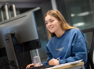 A person using a computer in the new psychology facilities at Surrey