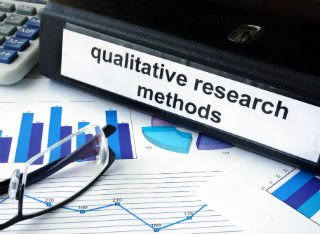 A desk with a Qualitative Research folder