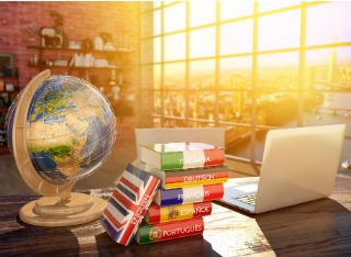 Globe and language dictionaries on a desk