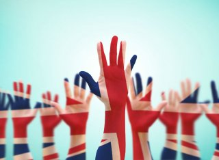 Hands are raised to vote in the UK general election