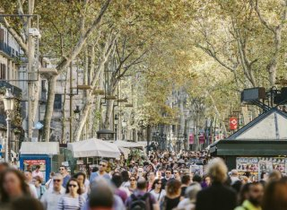 Las Ramblas in Barcelona with busy crowds walking down the street
